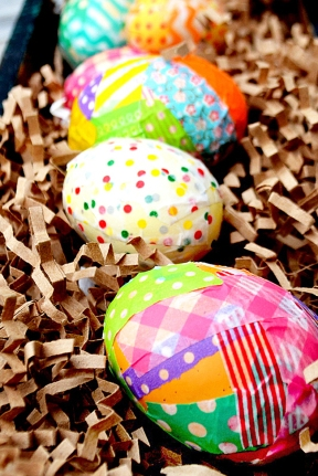 covering easter eggs with washi tape, colorful easter eggs, washi tape